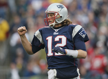 FOXBORO, MA - JANUARY 02:  Tom Brady #12 of the New England Patriots celebrates a touchdown by teammate BenJarvis Green-Ellis in the first quarter against the Miami Dolphins on January 2, 2011 at Gillette Stadium in Foxboro, Massachusetts.  (Photo by Elsa