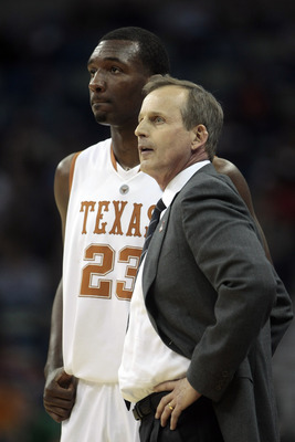 NEW ORLEANS - MARCH 18: Coach Rick Barnes of the Texas Longhorns talks with player Jordan Hamilton #23 near the end of an 81-80 loss to the Wake Forest Demon Deacons during the first round of the 2010 NCAA mens basketball tournament at the New Orleans Are