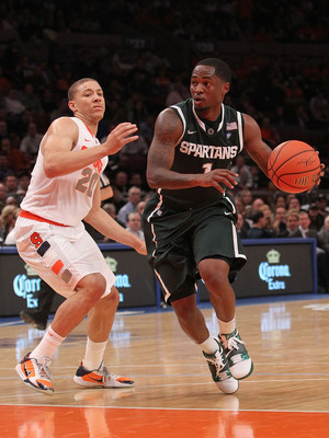 NEW YORK, NY - DECEMBER 07:  Kalin Lucas #1 of the Michigan Spartans drives to the basket alongside Brandon Triche #20 of the Syracuse Orange during their game at the Jimmy V Classic at Madison Square Garden on December 7, 2010 in New York City.  (Photo b