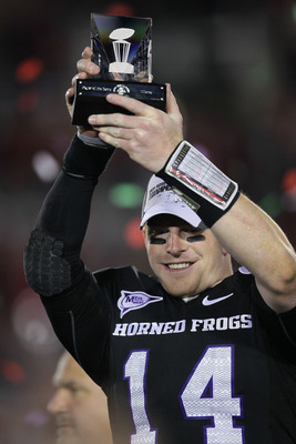 PASADENA, CA - JANUARY 01:  Quarterback Andy Dalton #14 of the TCU Horned Frogs holds the offensive player of the game trophy after defeating the Wisconsin Badgers 21-19 in the 97th Rose Bowl game on January 1, 2011 in Pasadena, California.  (Photo by Ste