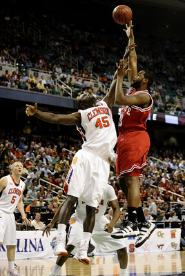 GREENSBORO, NC - MARCH 11:  Jerai Grant #45 of the Clemson Tigers guards Tracy Smith #23 of the NC State Wolfpack in their first round game in the 2010 ACC Men's Basketball Tournament at the Greensboro Coliseum on March 11, 2010 in Greensboro, North Carol