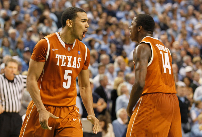 GREENSBORO, NC - DECEMBER 18:  Cory Joseph #5 of the Texas Longhorns reacts with J'Covan Brown #14 after Joseph hit what became the game-winning basket against the North Carolina Tar Heels Greensboro Coliseum on December 18, 2010 in Greensboro, North Caro