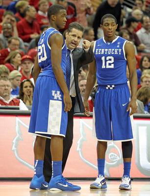 LOUISVILLE, KY - DECEMBER 31: John Calipari the Head Coach of the Kentucky Wildcats gives instructions to Doron Lamb #20 and Brandon Knight #12 during the game against the Louisville Cardinals at the KFC Yum! Center on December 31, 2010 in Louisville, Ken