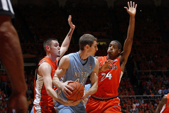 CHAMPAIGN, IL - NOVEMBER 30: Mike Tisdale #54 and Mike Davis #24 of the Illinois Fighting Illini defend against Tyler Zeller #44 of the North Carolina Tar Heels during the 2010 ACC/Big Ten Challenge at Assembly Hall on November 30, 2010 in Champaign, Illi