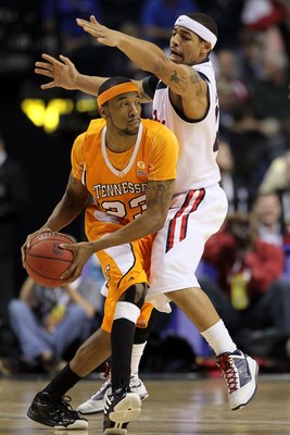 NASHVILLE, TN - MARCH 12:  Cameron Tatum #23 of the Tennessee Volunteers looks to pass against the Mississippi Rebels Tide during the quarterfinals of the SEC Men's Basketball Tournament at the Bridgestone Arena on March 12, 2010 in Nashville, Tennessee.
