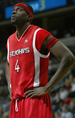 WASHINGTON DC - JANUARY 20:   Abe Keita #4 of the St. John's Red Storm during the game against the Georgetown Hoyas on January 20, 2004 at the MCI Center in Washington DC. Georgetown defeated St. John 71-69. (Photo by Doug Pensinger/Getty Images)