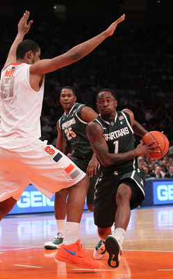NEW YORK, NY - DECEMBER 07:  Kalin Lucas #1 of the Michigan Spartans goes to the basket against Fab Melo #51 of the Syracuse Orange during their game at the Jimmy V Classic at Madison Square Garden on December 7, 2010 in New York City.  (Photo by Nick Lah