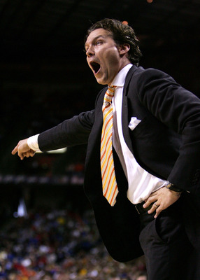 KANSAS CITY, MO - MARCH 11:  Head caoch Quin Snyder of the Missouri Tigers yells and points in the first half against the Oklahoma Sooners in Day 2 of the Phillips 66 Big 12 Men's Basketball Tournament at Kemper Arena on March 11, 2005 in Kansas City, Mis
