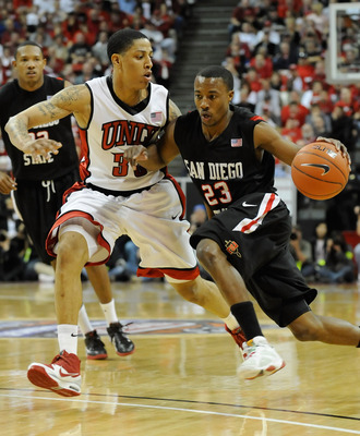 LAS VEGAS - MARCH 13:  D.J. Gay #23 of the San Diego State Aztecs drives against Tre'Von Willis #33 of the UNLV Rebels during the championship game of the Conoco Mountain West Conference Basketball tournament at the Thomas & Mack Center March 13, 2010 in