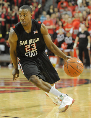 LAS VEGAS - JANUARY 13:  D.J. Gay #23 of the San Diego State Aztecs brings the ball up the court during a game against the UNLV Rebels at the Thomas & Mack Center January 13, 2009 in Las Vegas, Nevada. The Rebels defeated the Aztecs 76-66.  (Photo by Etha