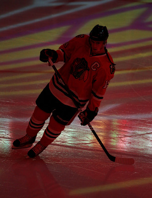 CHICAGO, IL - JANUARY 05: Jonathan Toews #19 of the Chicago Blackhawks skates during player introductions before a game against the Dallas Stars at the United Center on January 5, 2011 in Chicago, Illinois. The Stars defeated the Blackhawks 4-2.  (Photo b