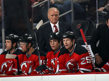 NEWARK, NJ - JANUARY 06:  Head coach Jacques Lemaire of the New Jersey Devils walks the bench during the game against the Philadelphia Flyers at the Prudential Center on January 6, 2011 in Newark, New Jersey. The Flyers defeated the Devils 4-2.  (Photo by