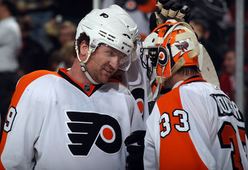 NEWARK, NJ - JANUARY 06:  Scott Hartnell #19 of the Philadelphia Flyers congratulates Brian Boucher #33 following a 4-2 win over the New Jersey Devils at the Prudential Center on January 6, 2011 in Newark, New Jersey.  (Photo by Bruce Bennett/Getty Images