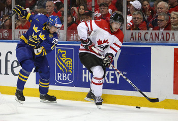 BUFFALO, NY - DECEMBER 31: Forward Sean Couturier #7 of Canada controls the puck during the 2011 IIHF World U20 Championship game between Canada and Sweden on December 31, 2010 at HSBC Arena in Buffalo, New York. (Photo by Tom Szczerbowski/Getty Images)