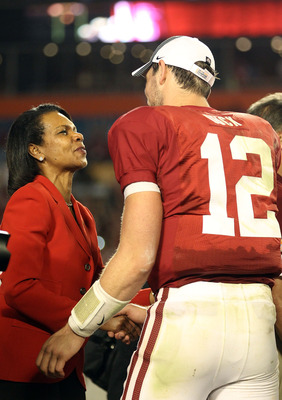 MIAMI, FL - JANUARY 03: Condoleezza Rice (L) congratulates Orange Bowl MVP Andrew Luck of the Stanford Cardinal after Stanford won 40-12 against the Virginia Tech Hokies during the 2011 Discover Orange Bowl at Sun Life Stadium on January 3, 2011 in Miami,