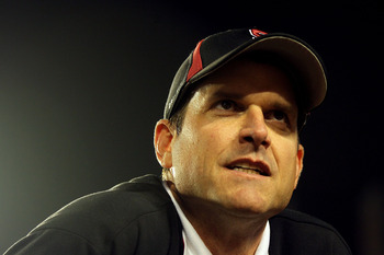 MIAMI, FL - JANUARY 03: Head coach Jim Harbaugh of the Stanford Cardinal looks on after Stanford won 40-12 against the Virginia Tech Hokies during the 2011 Discover Orange Bowl at Sun Life Stadium on January 3, 2011 in Miami, Florida. (Photo by Mike Ehrma