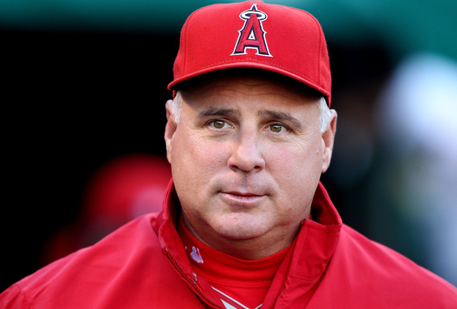 OAKLAND, CA - SEPTEMBER 3:  Manager Mike Scioscia of the Los Angeles Angels of Anaheim looks on against the Oakland Athletics during a Major League Baseball game at the Oakland-Alameda County Coliseum on September 3, 2010 in Oakland, California. (Photo by