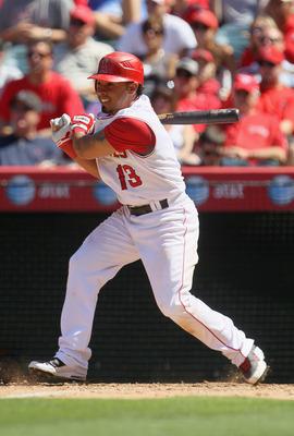 ANAHEIM, CA - AUGUST 11:  Maicer Izturis #13 of the Los Angeles Angels of Anaheim hits a single in the ninth inning against the Kansas City Royals at Angel Stadium on August 11, 2010 in Anaheim, California.  The Angels defeated the Royals 2-1 in ten innin