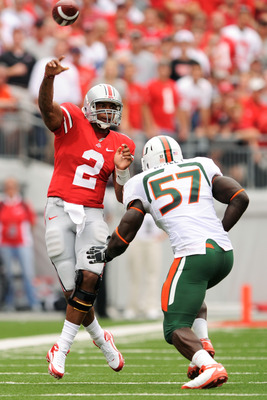 COLUMBUS, OH - SEPTEMBER 11:  Quarterback Terrelle Pryor #2 of the Ohio State Buckeyes gets off a pass as Allen Bailey #57 of the Miami Hurricanes applies pressure at Ohio Stadium on September 11, 2010 in Columbus, Ohio.  (Photo by Jamie Sabau/Getty Image