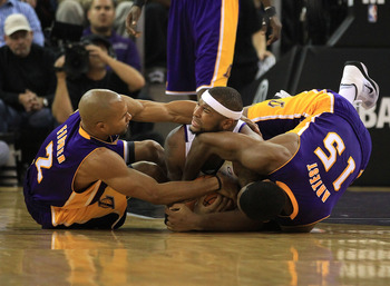 SACRAMENTO, CA - NOVEMBER 03:  Derek Fisher #2 and Ron Artest #15 of the Los Angeles Lakers wrestle for the ball with DeMarcus Cousins #15 of the Sacramento Kings at ARCO Arena on November 3, 2010 in Sacramento, California.  NOTE TO USER: User expressly a