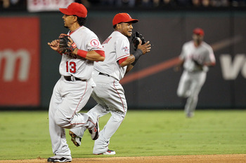 ARLINGTON, TX - OCTOBER 01:  Shortstop Erick Aybar #2 of the Los Angeles Angels of Anaheim makes the fly out against Julio Borbon of the Texas Rangers at Rangers Ballpark in Arlington on October 1, 2010 in Arlington, Texas.  (Photo by Ronald Martinez/Gett