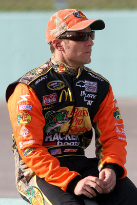 HOMESTEAD, FL - NOVEMBER 19:  Jamie McMurray, driver of the #1 Bass Pro Shops Chevrolet, sits on pit wall during qualifying for the NASCAR Sprint Cup Series Ford 400 at Homestead-Miami Speedway on November 19, 2010 in Homestead, Florida.  (Photo by Jerry