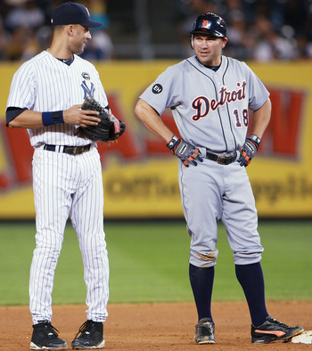 NEW YORK - AUGUST 18:  Johnny Damon #18 of the Detroit Tigers talks with Derek Jeter #2 of the New York Yankees during a game at Yankee Stadium on August 18, 2010 in the Bronx borough of New York City.  The Yankees won 9 - 5. (Photo by Andrew Burton/Getty