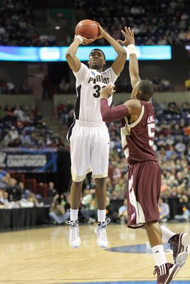SPOKANE,WA - MARCH 21: E'Twaun Moore #33 of the Purdue Boilermakers makes a jumpshot against Dash Harris #5 of the Texas A&M Aggies during the second round of the 2010 NCAA men's basketball tournament at the Spokane Arena on March 21, 2010 in Spokane, Was