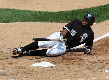 CHICAGO - AUGUST 01: Andruw Jones #25 of the Chicago White Sox hits the ground after being hit by a pitch from Gio Gonzalez of the Oakland Athletics at U.S. Cellular Field on August 1, 2010 in Chicago, Illinois. (Photo by Jonathan Daniel/Getty Images)