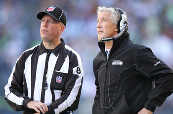 SEATTLE - NOVEMBER 07:  Head coach Pete Carroll of the Seattle Seahawks looks at the scoreboard as he awaits the ruling on a challenge with Field Judge Jon Lucivansky  during the game against the New York Giants at Qwest Field on November 7, 2010 in Seatt
