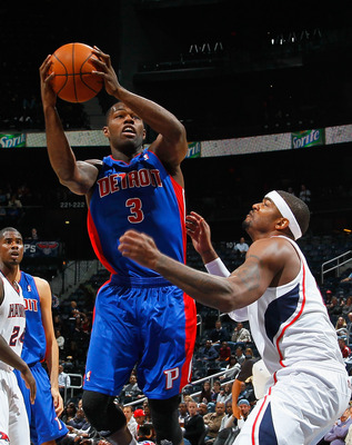ATLANTA - NOVEMBER 03:  Rodney Stuckey #3 of the Detroit Pistons drives against Josh Smith #5 of the Atlanta Hawks at Philips Arena on November 3, 2010 in Atlanta, Georgia.  NOTE TO USER: User expressly acknowledges and agrees that, by downloading and/or