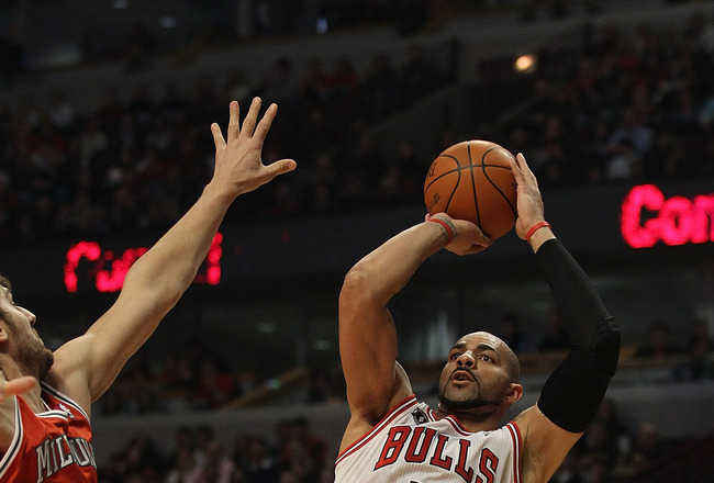 CHICAGO, IL - DECEMBER 28: Carlos Boozer #5 of the Chicago Bulls puts up a shot against Andrew Bogut #6 of the Milwaukee Bucks at the United Center on December 28, 2010 in Chicago, Illinois. The Bulls defeated the Bucks 90-77. NOTE TO USER: User expressly
