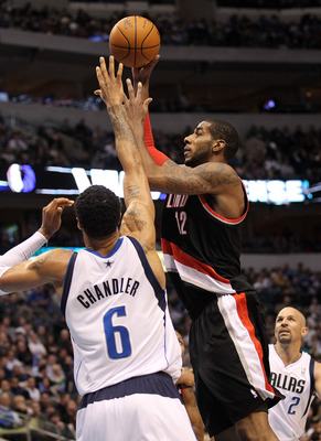 DALLAS, TX - JANUARY 04:  Forward LaMarcus Aldridge #12 of the Portland Trail Blazers takes a shot against Tyson Chandler #6 of the Dallas Mavericks at American Airlines Center on January 4, 2011 in Dallas, Texas.  NOTE TO USER: User expressly acknowledge