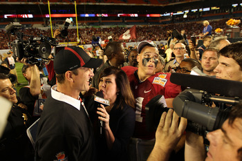 MIAMI, FL - JANUARY 03: Head coach Jim Harbaugh of the Stanford Cardinal is interviewed by ESPN's Michelle Tafoya after Stanford won 40-12 against the Virginia Tech Hokies during the 2011 Discover Orange Bowl at Sun Life Stadium on January 3, 2011 in Miam