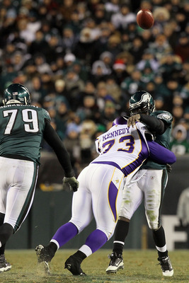 PHILADELPHIA, PA - DECEMBER 28:  Michael Vick #7 of the Philadelphia Eagles in action against Jimmy Kennedy #73 of the Minnesota Vikings at Lincoln Financial Field on December 26, 2010 in Philadelphia, Pennsylvania.  (Photo by Jim McIsaac/Getty Images)