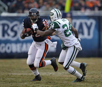 CHICAGO, IL - DECEMBER 26: Matt Forte #22 of the Chicago Bears runs as Darrelle Revis #24 of the New York Jets closes in at Soldier Field on December 26, 2010 in Chicago, Illinois.  The Bears defeated the Jets 38-34. (Photo by Jonathan Daniel/Getty Images