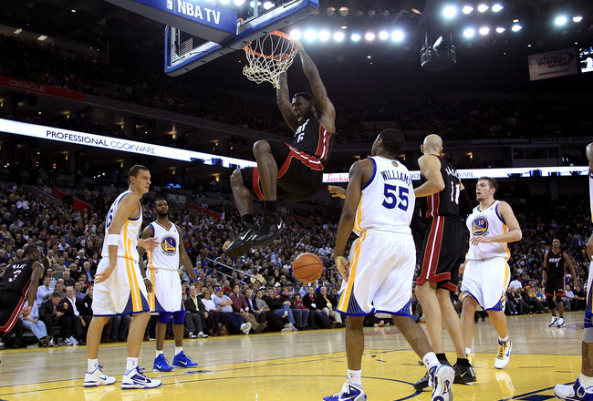 OAKLAND, CA - DECEMBER 10:  Lebron James #6 of the Miami Heat dunks the ball against the Golden State Warriors at Oracle Arena on December 10, 2010 in Oakland, California. NOTE TO USER: User expressly acknowledges and agrees that, by downloading and or us