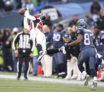 SEATTLE, WA - DECEMBER 19:  Brent Grimes #20 of the Atlanta Falcons makes an interception against Ben Obomanu #87 of the Seattle Seahawks at Qwest Field on December 19, 2010 in Seattle, Washington. The Falcons defeated the Seahawks 34-18. (Photo by Otto G