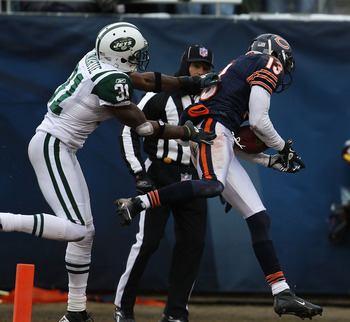 CHICAGO, IL - DECEMBER 26: Johnny Knox #13 of the Chicago Bears catches a touchdown pass in front of Antonio Cromartie #31 of the New York Jets at Soldier Field on December 26, 2010 in Chicago, Illinois. The Bears defeated the Jets 38-34. (Photo by Jonath