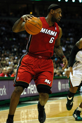 MILWAUKEE, WI - JANUARY 07: LeBron James #6 of the Miami Heat dribbles in the first quarter against the Milwaukee Bucks at the Bradley Center on January 7, 2011 in Milwaukee, Wisconsin. NOTE TO USER: User expressly acknowledges and agrees that, by downloa