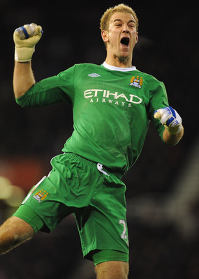 STOKE ON TRENT, ENGLAND - NOVEMBER 27:  Joe Hart of Manchester City celebrates Micah Richards goal during the Barclays Premier League match between Stoke City and Manchester City at Britannia Stadium on November 27, 2010 in Stoke on Trent, England.  (Phot