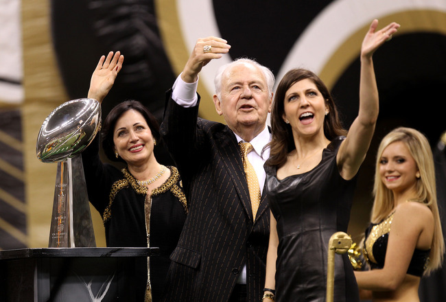 NEW ORLEANS - SEPTEMBER 09:  Team Owner of the New Orleans Saints Tom Benson, his wife Gayle and his daughter Rita Benson Leblanc wave to the fans as they ride a float, displaying the VInce Lombardi trophy, out onto the field prior to the Saints playing a