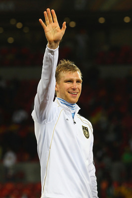 PORT ELIZABETH, SOUTH AFRICA - JULY 10:  Per Mertesacker of Germany celebrates victory and third place following the 2010 FIFA World Cup South Africa Third Place Play-off match between Uruguay and Germany at The Nelson Mandela Bay Stadium on July 10, 2010