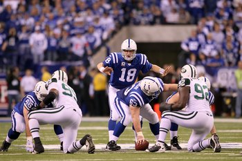 INDIANAPOLIS - JANUARY 24:  Quarterback Peyton Manning #18 of the Indianapolis Colts under center during the second half against the New York Jets during the AFC Championship Game at Lucas Oil Stadium on January 24, 2010 in Indianapolis, Indiana. The Colt