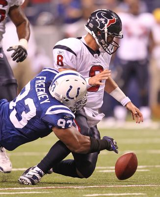 INDIANAPOLIS - NOVEMBER 01:  Matt Schaub #8 of Houston Texans fumbles the ball while being tackled  by Dwight Freeney #93 of the Indianapolis Colts during the NFL game at Lucas Oil Stadium on November 1, 2010 in Indianapolis, Indiana.  (Photo by Andy Lyon