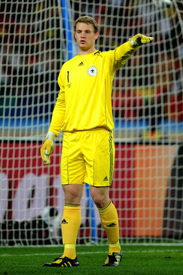 DURBAN, SOUTH AFRICA - JULY 07:  Manuel Neuer of Germany directs his defence during the 2010 FIFA World Cup South Africa Semi Final match between Germany and Spain at Durban Stadium on July 7, 2010 in Durban, South Africa.  (Photo by Clive Mason/Getty Ima