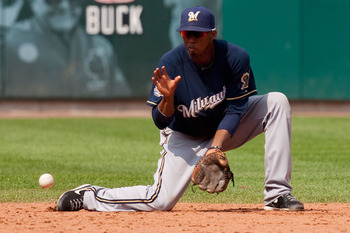 ST. LOUIS - AUGUST 18: Alcides Escobar #21 of the Milwaukee Brewers fields a ground ball against the St. Louis Cardinals at Busch Stadium on August 18, 2010 in St. Louis, Missouri.  The Brewers beat the Cardinals 3-2.  (Photo by Dilip Vishwanat/Getty Imag