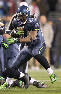 SEATTLE, WA - JANUARY 02:  Running back Marshawn Lynch #24 of the Seattle Seahawks rushes with the ball against the St. Louis Rams during their game at Qwest Field on January 2, 2011 in Seattle, Washington.  (Photo by Otto Greule Jr/Getty Images)
