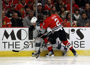 CHICAGO, IL - DECEMBER 30: Duncan Keith #2 of the Chicago Blackhawks checks Benn Ferriero #78 of the San Jose Sharks at the United Center on December 30, 2010 in Chicago, Illinois. The Sharks defeated the Blackhawks 5-3. (Photo by Jonathan Daniel/Getty Im