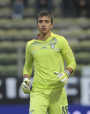 PARMA, ITALY - NOVEMBER 21:  Fernando Muslera, goalkeeper of Lazio looks on during the Serie A match between Parma and Lazio at Stadio Ennio Tardini on November 21, 2010 in Parma, Italy.  (Photo by Dino Panato/Getty Images)